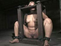 Asian girl in metal bondage