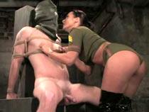 Mistress interrogates prisoner
