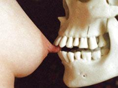 Skull bites a nipple