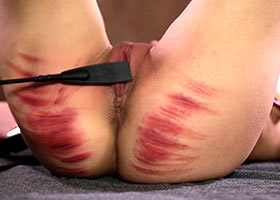 Painful flogging of her ass and pussy