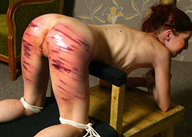 Brutal punishment till red marks at slave school