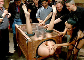 Public fucking of slave girl in a box