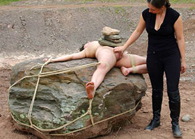 Outdoor torture with heavy natural stones