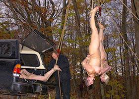 Group hanging upside down of captured girls