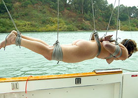 Naked girl suspended on a boat after party
