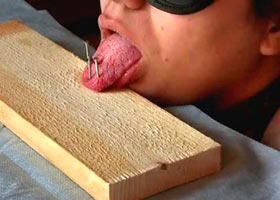 Painful nailing of the tongue to the board