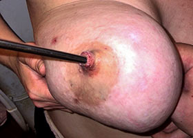 Sadistic nipple penetration with a metal rod
