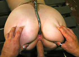 Fucking of bound bitch with the hook in her ass